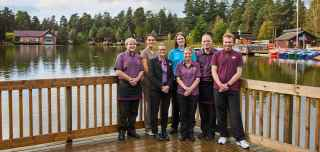 Father with daughter on shoulders walking through the forest