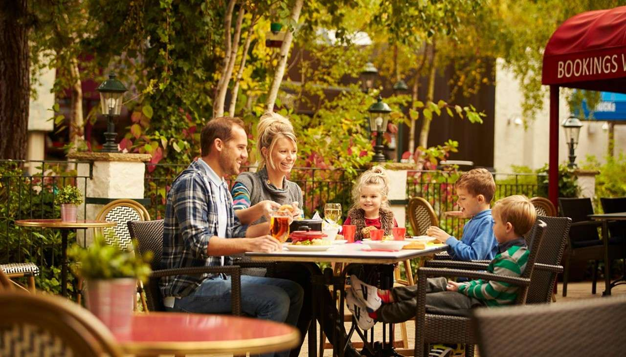 Family dining outside at Cafe Rouge