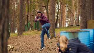 Parents with young boy in inflatable in the Subtropical Swimming Paradise