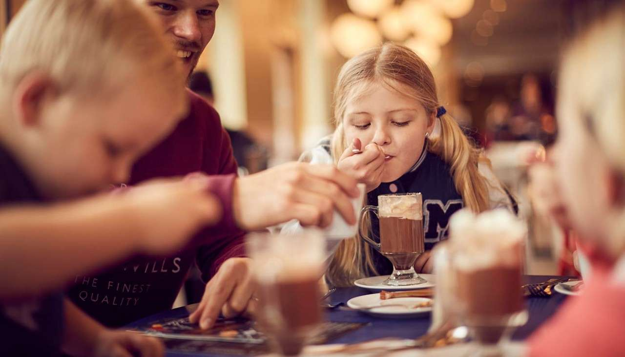Family enjoying got chocolates at The Pancake House