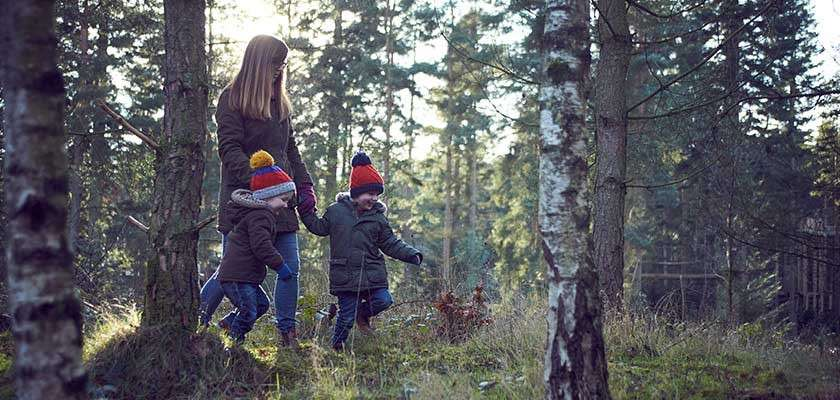Mum with two kids in the forest in winter