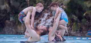 Parent and two children in the Subtropical Swimming Paradise