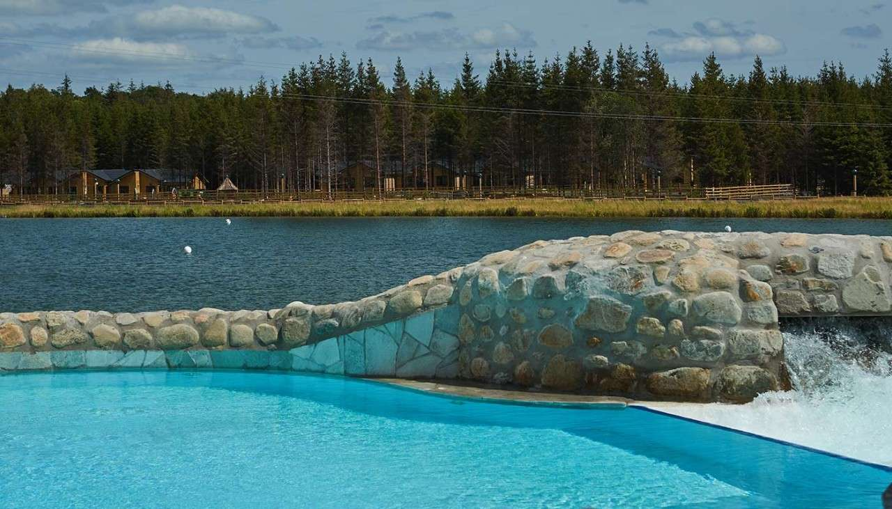 Outdoor pool with view of the lake
