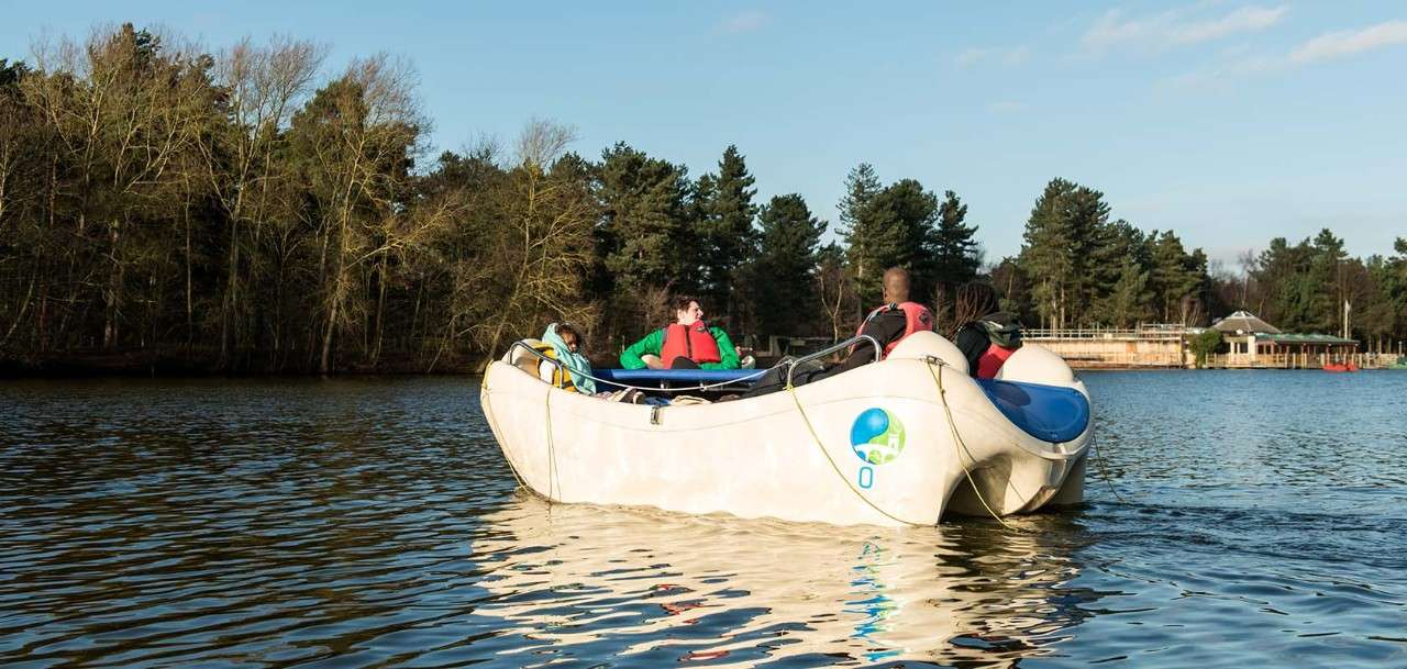 Family aboard an electric boat at Center Parcs