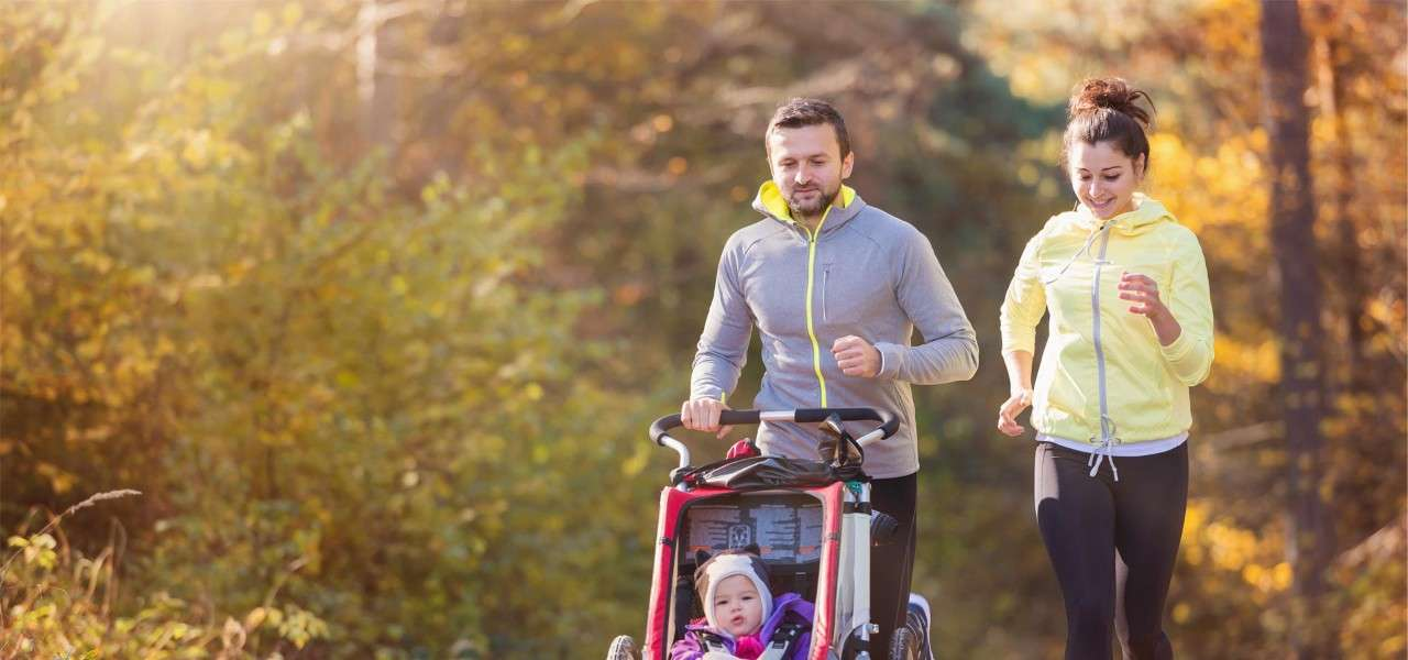 couple jogging with pushchair