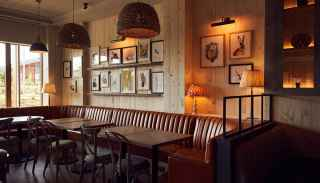 Corner of Cara's with family seating area, and framed illustrations on the walls